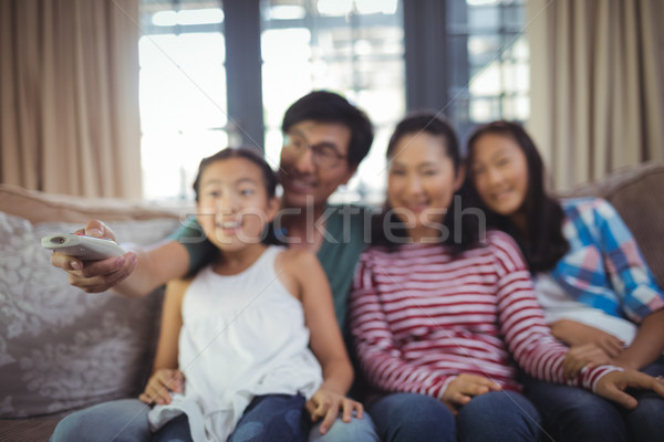 Smiling family watching television together in living room Stock photo © wavebreak_media