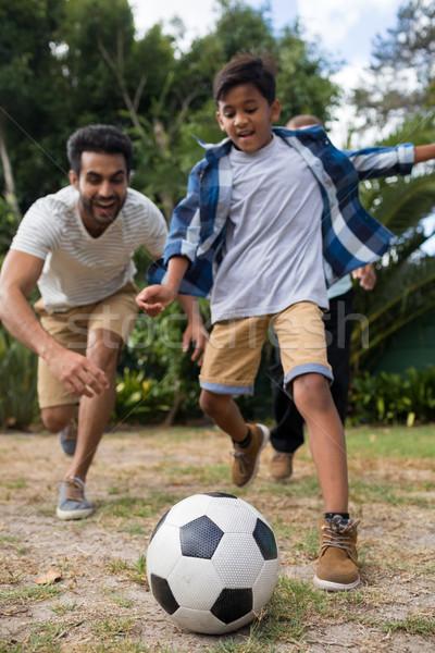 Playful family playing soccer on field Stock photo © wavebreak_media