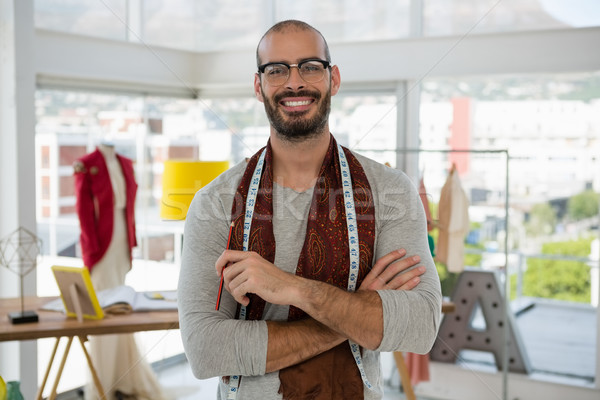 Portrait of smiling male designer with arms crossed in studio Stock photo © wavebreak_media
