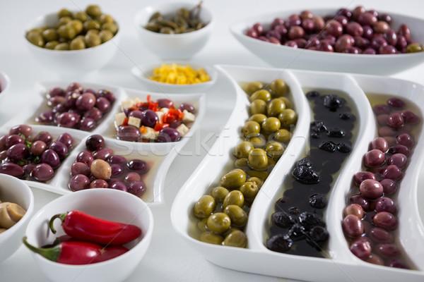 Marinated olives and vegetables on white background Stock photo © wavebreak_media