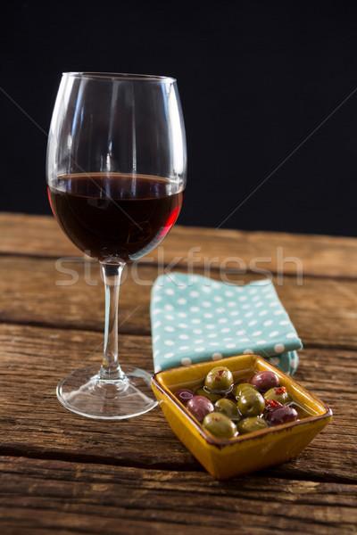 Primo piano marinato olive vetro vino tavola Foto d'archivio © wavebreak_media