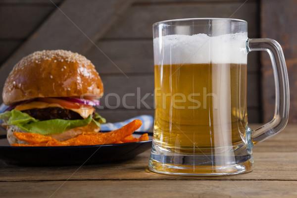 ハンバーガー フライドポテト プレート ガラス ビール 木製のテーブル ストックフォト © wavebreak_media