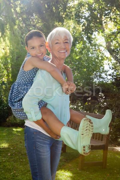 Portrait of grandmother piggybacking granddaughter Stock photo © wavebreak_media