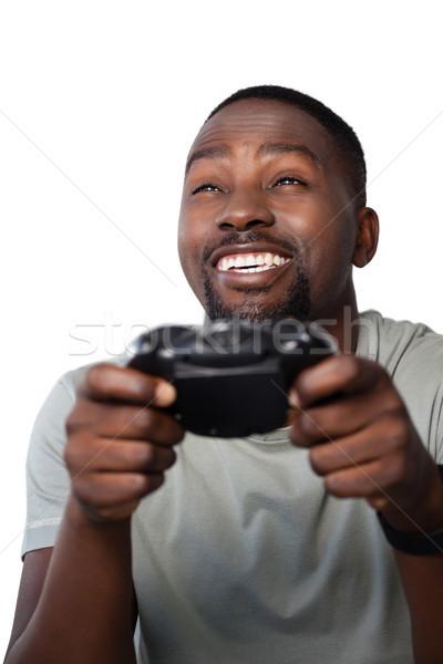 Gülen adam oynama video oyunu beyaz Stok fotoğraf © wavebreak_media