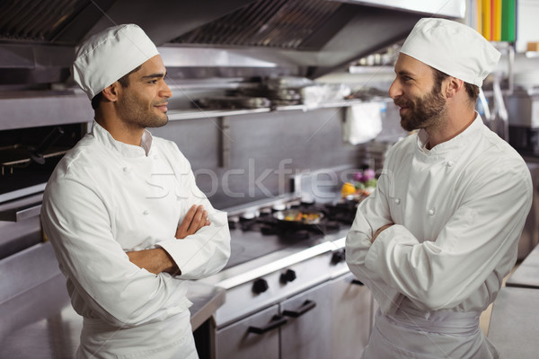 Chefs interacting with each other in kitchen Stock photo © wavebreak_media