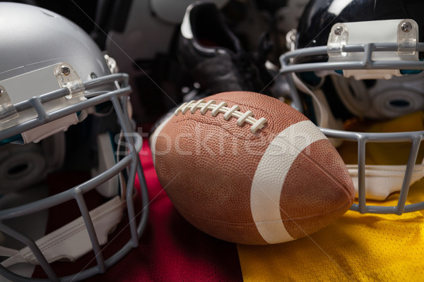 Close up of American football with helmets on jersey Stock photo © wavebreak_media