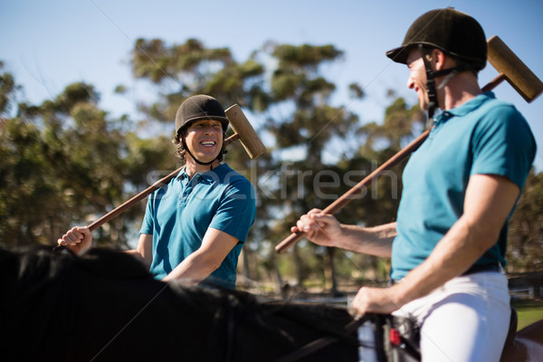 Two male jockeys riding horse in the ranch Stock photo © wavebreak_media