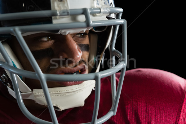 Determined American football player with a head gear Stock photo © wavebreak_media