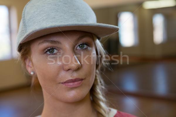 Portrait of female dancer wearing cap Stock photo © wavebreak_media