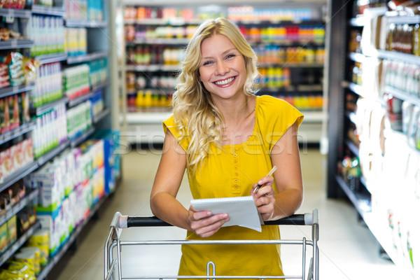 Blonde smiling woman checking list Stock photo © wavebreak_media