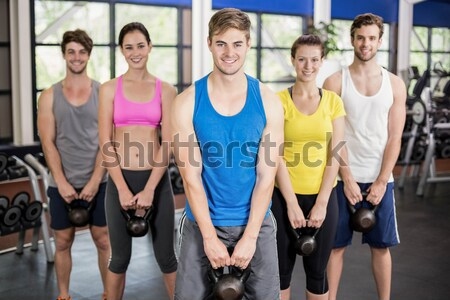 Smiling women posing together with hands on hips  Stock photo © wavebreak_media