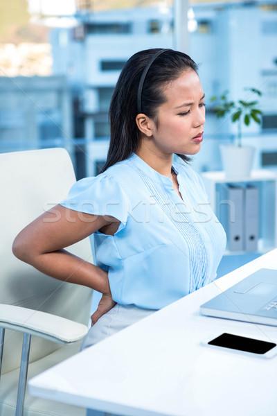 Triest zakenvrouw rugpijn bureau computer telefoon Stockfoto © wavebreak_media