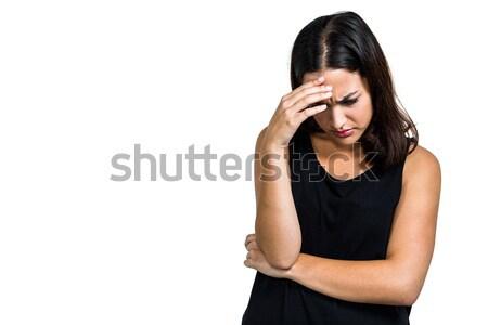 Depressed woman with hand on head  Stock photo © wavebreak_media