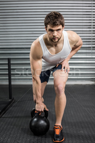 Stock photo: Fit man lifting dumbbells