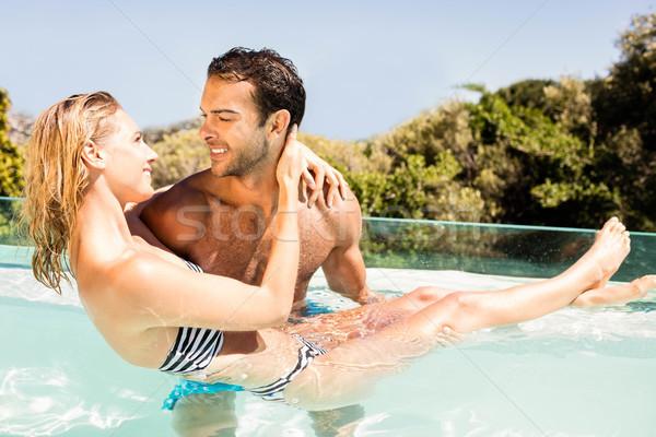 Jóképű férfi hordoz barátnő medence nő szeretet Stock fotó © wavebreak_media