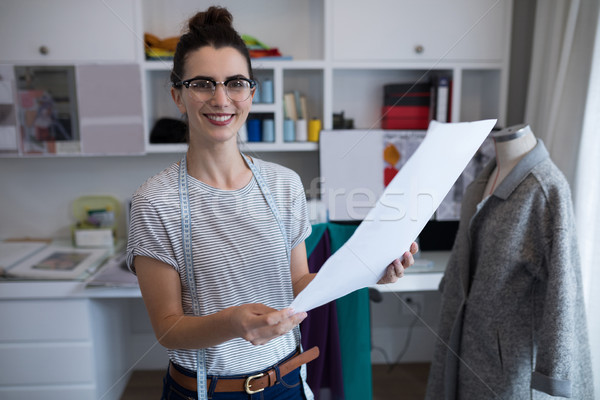 Fashion designer holding a document Stock photo © wavebreak_media