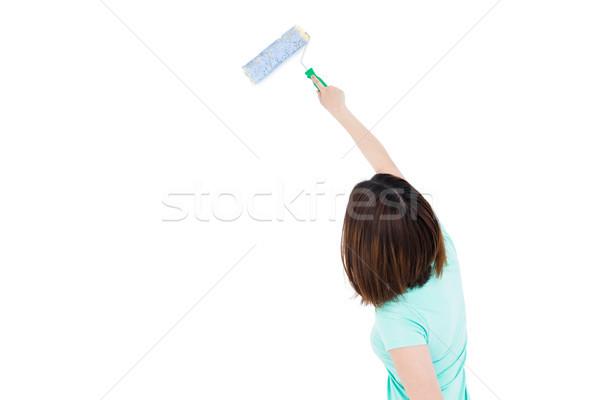 Kobieta malarstwo gąbki kobiet t-shirt życia Zdjęcia stock © wavebreak_media