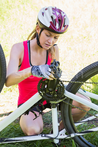 Woman fixing her bike Stock photo © wavebreak_media
