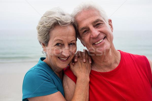 Happy senior couple embracing each other on the beach Stock photo © wavebreak_media