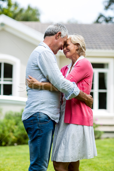 Happy senior couple standing outside house in yard  Stock photo © wavebreak_media