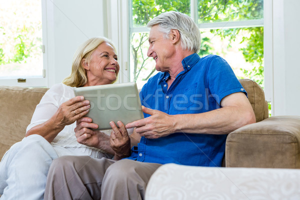 Cheerful senior couple using digital tablet at home Stock photo © wavebreak_media