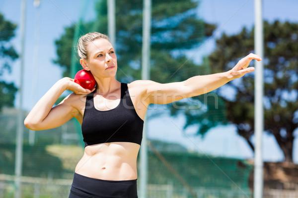 Female athlete preparing to throw shot put ball Stock photo © wavebreak_media