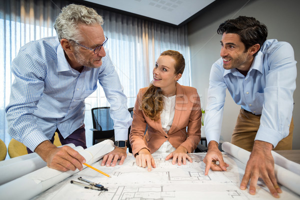 Businesswoman and coworkers discussing blueprint Stock photo © wavebreak_media