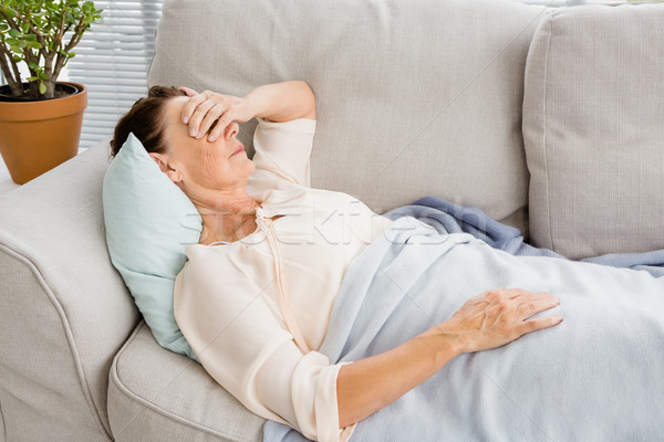 Mulher madura dor de cabeça sofá casa homem saúde Foto stock © wavebreak_media