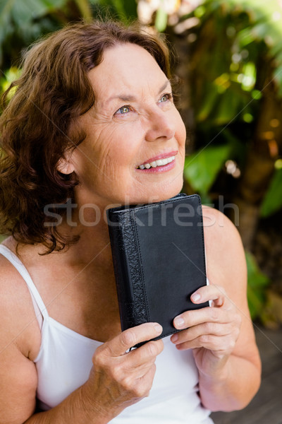 улыбаясь Библии человека Сток-фото © wavebreak_media