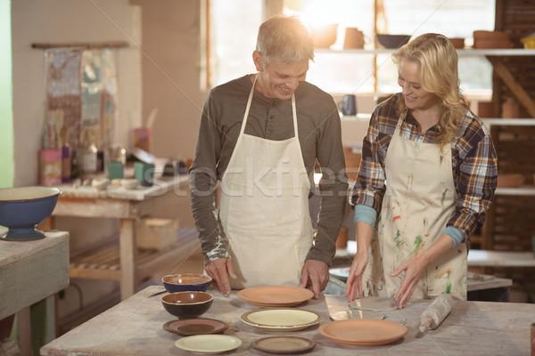 Travail poterie atelier souriant femme art Photo stock © wavebreak_media