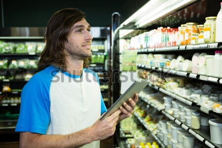 Man shopping in grocery section Stock photo © wavebreak_media