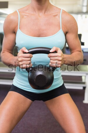 Midsection of female athlete touching belly in gym Stock photo © wavebreak_media