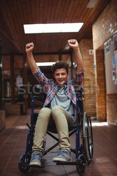 Niepełnosprawnych uczeń wózek korytarz szkoły podniecony Zdjęcia stock © wavebreak_media
