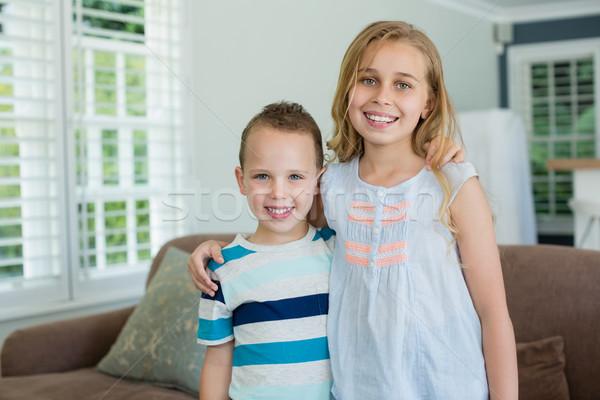 肖像 笑みを浮かべて 姉妹 弟 立って 腕 ストックフォト © wavebreak_media