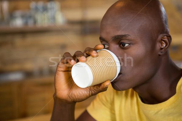 молодым человеком питьевой кофе кафе таблице Сток-фото © wavebreak_media