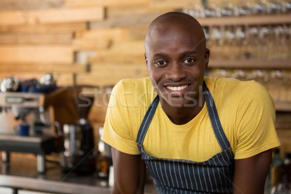 Smiling male barista in coffee shop Stock photo © wavebreak_media