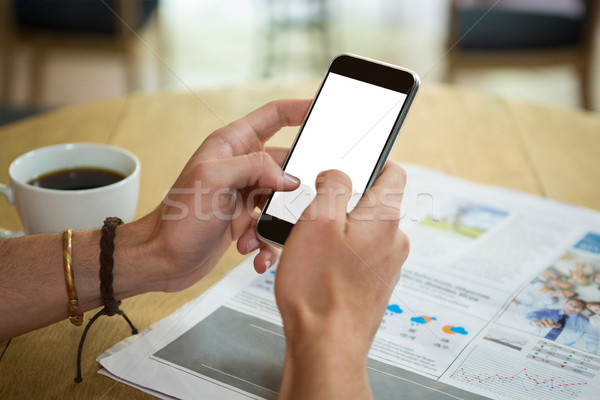Man using mobile phone at table in coffee shop Stock photo © wavebreak_media