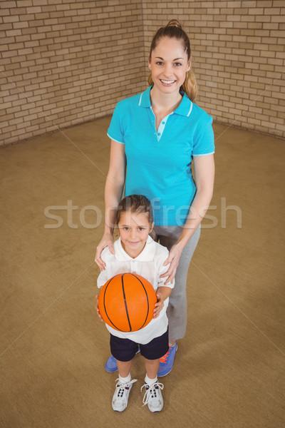 Studenten halten Basketball Lehrer Frau Mädchen Stock foto © wavebreak_media