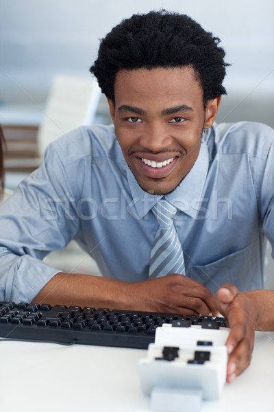Afro-American businessman consulting his business card holder Stock photo © wavebreak_media