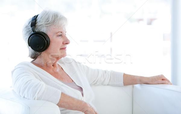 старший женщину прослушивании музыку наушники сидят Сток-фото © wavebreak_media