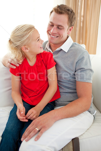 Adorable little girl sitting on sofa with her father Stock photo © wavebreak_media