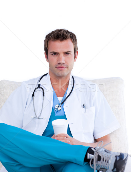 Confident male doctor drinking coffee in the staff room Stock photo © wavebreak_media