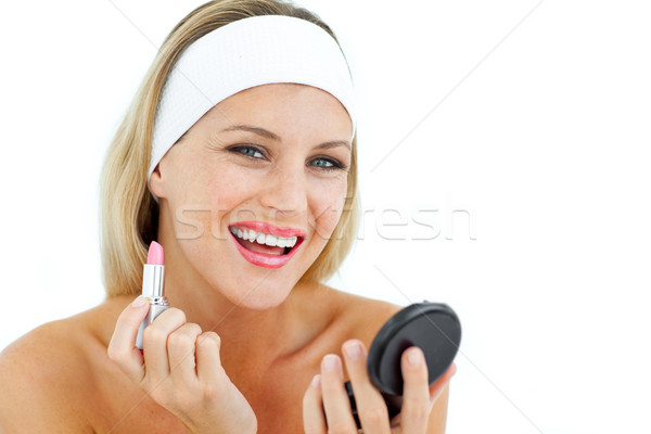 Smiling woman holding a lipstick  Stock photo © wavebreak_media