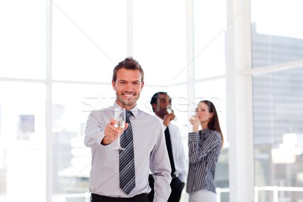 Gens d'affaires célébrer succès champagne jeunes bureau Photo stock © wavebreak_media