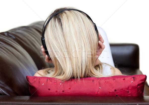 Jonge vrouw hoofdtelefoon sofa gelukkig rock leuk Stockfoto © wavebreak_media