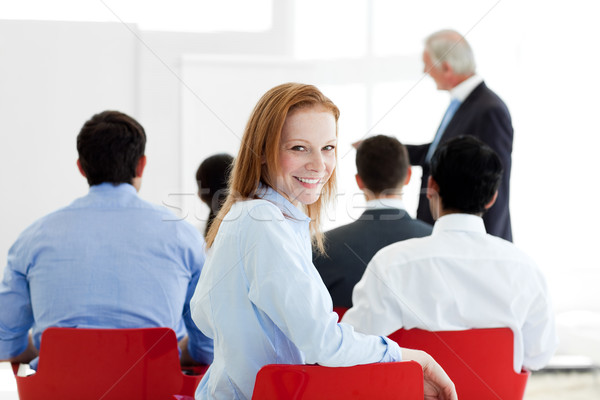 Smiling caucasian businesswoman at a conference in the office Stock photo © wavebreak_media