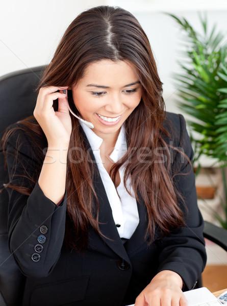 ázsiai üzletasszony visel fejhallgató lemez iroda Stock fotó © wavebreak_media