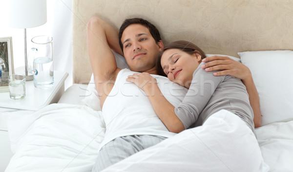 Férfi álmodik ágy megnyugtató barátnő otthon Stock fotó © wavebreak_media