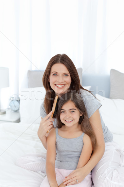 Woman brushing her daughter hair at home Stock photo © wavebreak_media