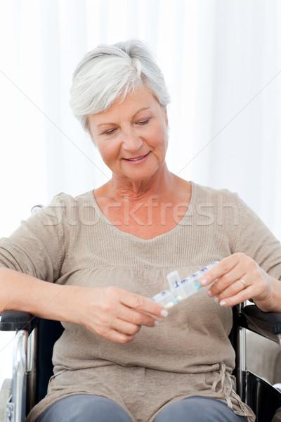 Idős tolószék tabletták űr idős nevetés Stock fotó © wavebreak_media